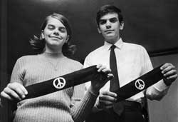 Mary Beth and John Tinker with their black arm bands.